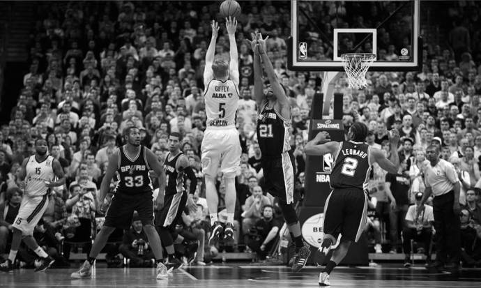 Giffey shoots over Tim Duncan of the Spurs